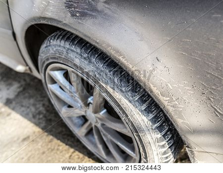 Part of a dirty stained car close up.