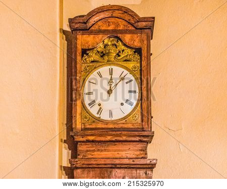 A vintage wooden clock in an old country house.