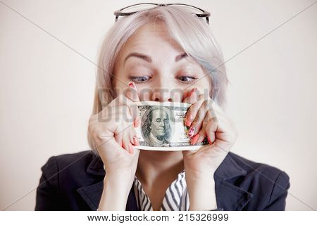 Business Woman Covering Her Mouth With A Dollar Banknote As Symbol Of Bribery Cheating Financia And