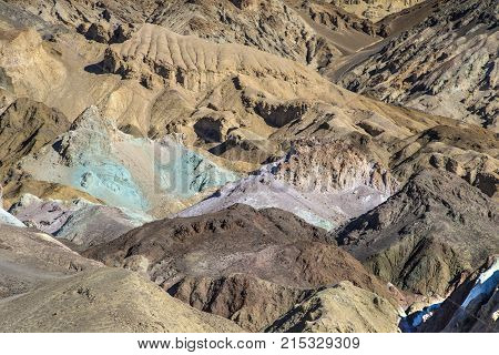 Colorful and rugged eroded badlands along Artist Palette road colored by various kinds of minerals.