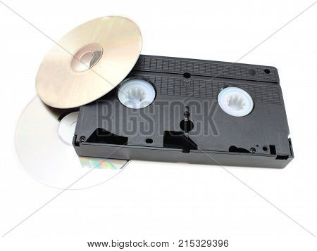 DVD disks and VHS video the cartridge on a white background in time and technology comparison