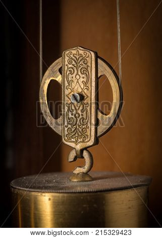 Detail Of An Old Pendulum Clock, Ornamented Wheel
