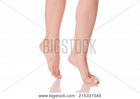 Female feet heels on toes isolated on white background isolation