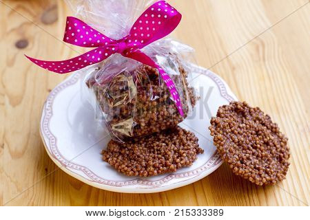 aerated rice with chocolate in a gift box with a pink ribbon