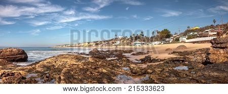 Rocky Shore With Beach Cottages Lining Crystal Cove State Park Beach