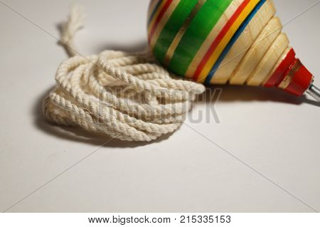 Mexican wooden toy (trompo) with its rope