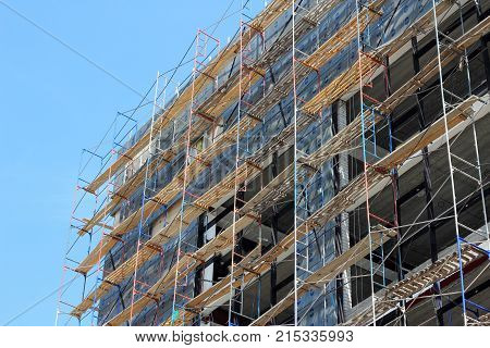 construction of a building against the blue sky