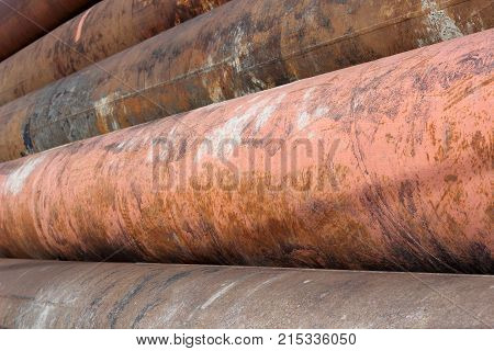 Rusty pipes for a heating main in the ground