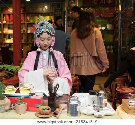 Chinese Woman With Traditional Dress Preparing Green Tea Ceremony