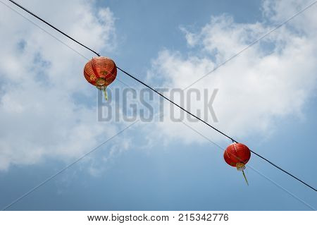 asian style lantern hanging against the blue sky background