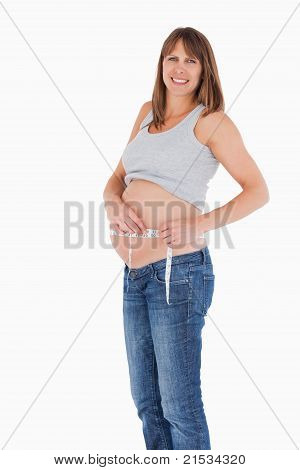 Good Loooking Pregnant Woman Measuring Her Belly While Standing