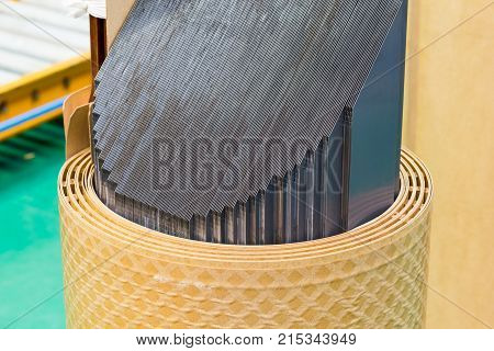 Transformer stacking core made of step lap lamination of cold rolled grain oriented (CRGO) silicon steel in circular shape focusing on the cutting edge of 45 degree joint showing the step lap joint