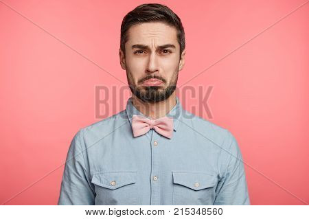 Unhappy Gloomy Bearded Attractive Male Curves Lip Has Sorrorful Expression As Recieves Refusal From