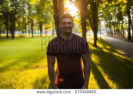 handsome muscular smiling man photo portrait. lifestyle of active and self-confident people. walk in the park