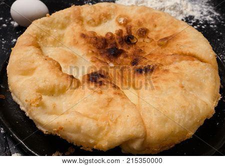 nourishing imeretian khachapuri recipe. fatty delicious unhealthy food. georgian cuisine