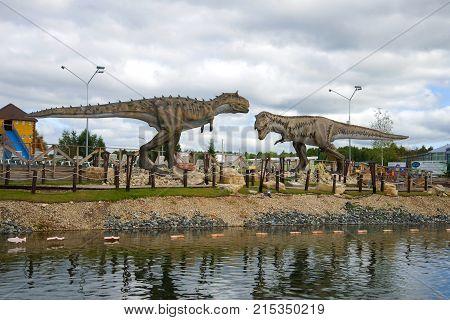KIROV, RUSSIA - AUGUST 30, 2017: Tyrannosaurus Rex and carnotaurus. Sculptures of predatory dinosaurs in the children's Park