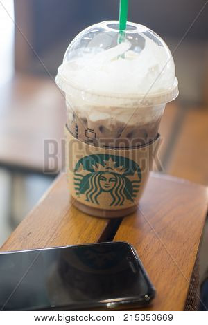 Bangkok Thailand - Aug 19 2017: Cup of Starbucks ice coffee with whipped cream in Starbucks coffee shop