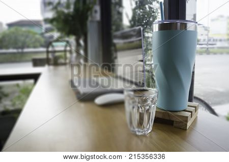 Work table with laptop and drink stock photo
