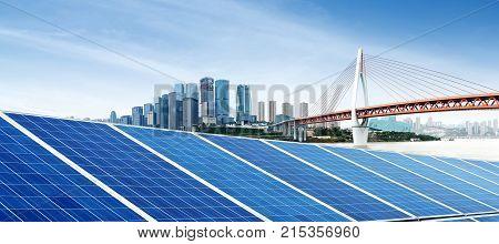 Photo voltaic and modern city skyline China Chongqing.