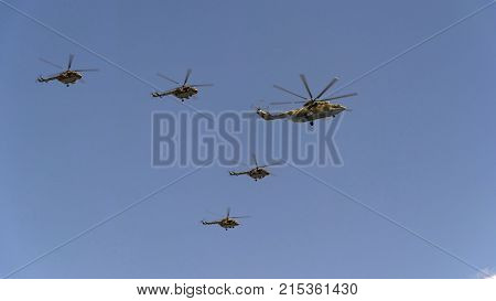 Combat Helicopters Mi-26 And Mi-8 Fly In Sky