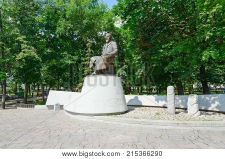 MOSCOW RUSSIA - JULY 23 2016: Monument to Kazakh poet and thinker Abay Kunanbayev Moscow Russia. Unknown people are resting in park on Chistoprudniy boulevard