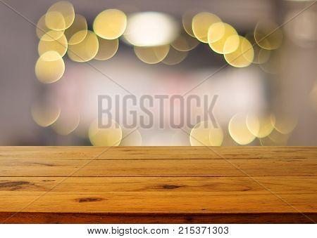 Wooden board empty table in front of blurred background.Perspective brown wood and blur of bokeh light background/selective focus .For montage product display.