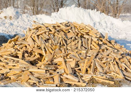 Firewood. A Lot Of Firewood Lie In A Heap.