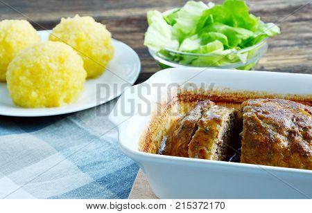 Meat Loaf with potato dumplings and Green green salad (German name are Hackbraten oder Faschierter Braten mit Kartoffelknödel und Grüner Salat.)