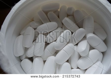 White Tub Filled With Calcium Caplets From Above
