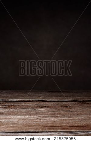 Vertical shot of elegant brown wooden texture on a brown background with copy space. Wooden background.