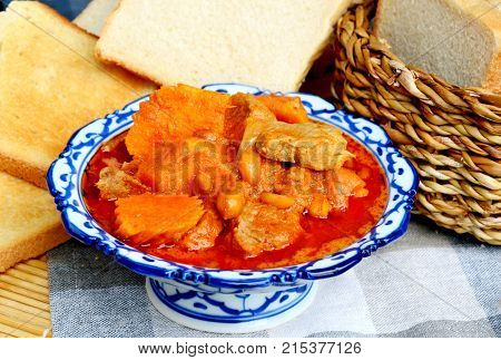 close up from Massaman Curry with toast  (Thai name is Gaeng Massaman)