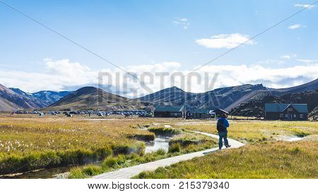 Tourist On Path To Landmannalaugar In Iceland