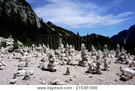 Viewpoint with stone piles Vrsic pass and Triglav Mountains Slovenia