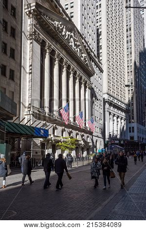 NEW YORK-NOVEMBER 20: People enjoy a walk past the New York Stock Exchange on November 20 2017 in lower Manhattan.