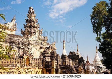 The brick yellow Maha Aung Mye Bon Zan monastery on the Inwa royal site near Mandalay