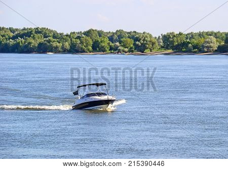 Motorboat on the river in summer time