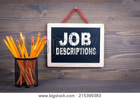 Job Descriptions. Career and success concept. Chalkboard on a wooden background.