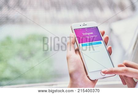 Bangkok Thailand - November 26, 2017 : Hand is pressing the Login Screen Instagram icons on Apple iPhone 6. largest and most popular social networking site in the world.