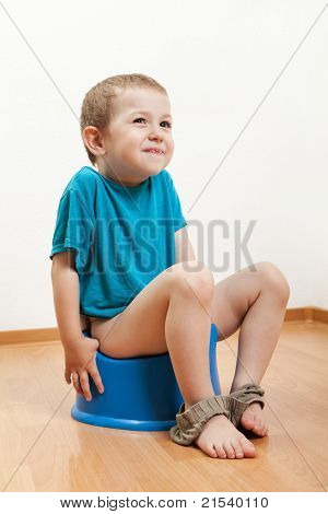Child Sitting On Toilet Potty
