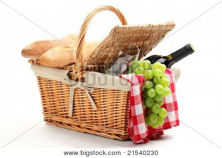 Picnic basket filled with fruit,bread and red wine.
