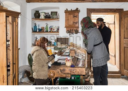 Sighisoara Romania October 08 2017 : The saleswoman serves customers in the souvenir shop in old city of Sighisoara in Romania