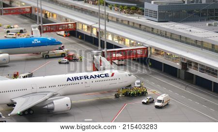 HAMBURG, GERMANY - MARCH 8th, 2014: A Boeing 777 model of Air France waiting for pushback at Flughafen Wunderland. Up to 40 different aircrafts, from Cessna to Airbus A 380, are taxing independently on Knufingen Airport at Miniatur Wunderland Museum to th