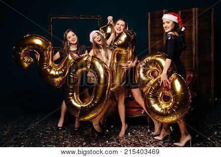 Girls Having Fun At Christmas Party