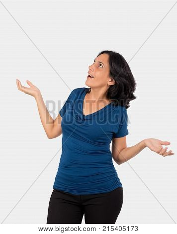 Astonished womandwith open arms and open mouth she is wearing a blue blouse