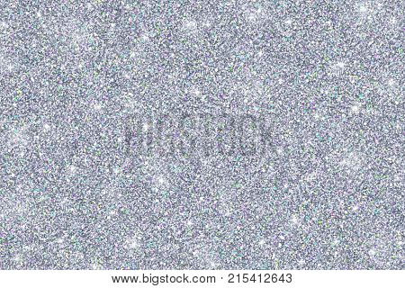 Glitter texture of silvery color, abstract silver background