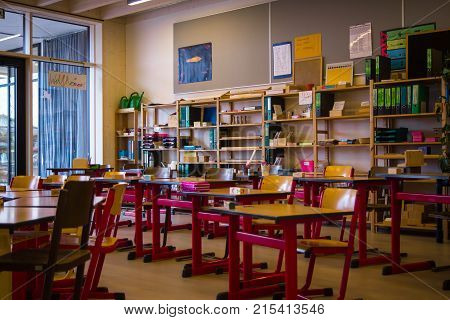 NeuoettingGermany-Nov 112017: Desks and teaching materials in a classroom at a montessori school