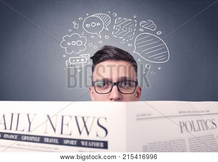 Puzzled young businessman reading daily newspaper with speech bubbles above his head