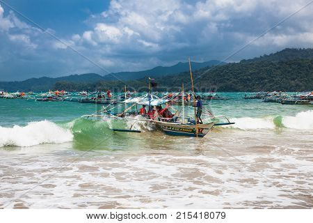 SABANG, PHILIPPINES-MARCH 27, 2016:Longtail boats line from Sabangto cave entrance of Puerto Princesa subterranean underground river, one of the 7 New Wonders of Nature, on March 27, 2016.Philippines