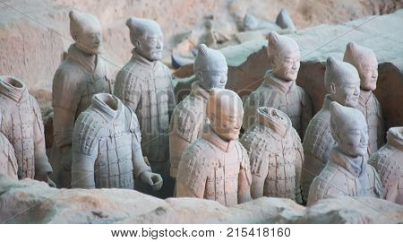 XIAN, CHINA - October 8, 2017: Famous Terracotta Army in Xi'an, China. The mausoleum of Qin Shi Huang, first Emperor of China contains collection of terracotta sculptures of armored men and horses.