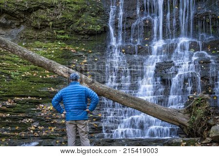 a male visitor at Jackson Falls at Natchez Trace Parkway, fall scenery